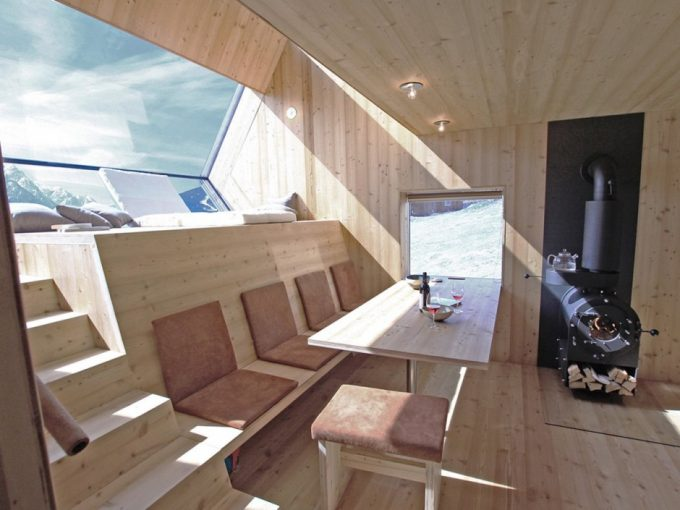 Living Space With Wooden Bench And Wood Table Also Warm Interior The Small House Design Idea