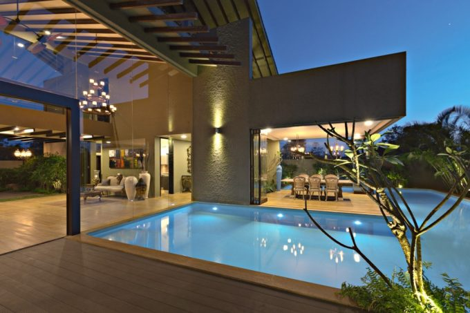 Lovely Swimming And Wooden Deck Patio With Small Tree Decor Also Glass Wall