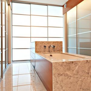 Modern Bathroom Design With Marble Framed Tubiand Frosted Wall Glass