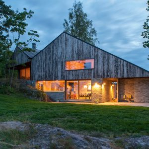 Modern Lodge House Design With Wood And Glass Exterior And Natural Forest Surrounding
