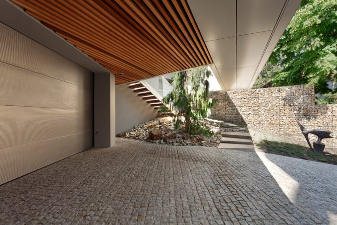 Paved Alley And Auto Garage Door With Wood Ceiling Car Park