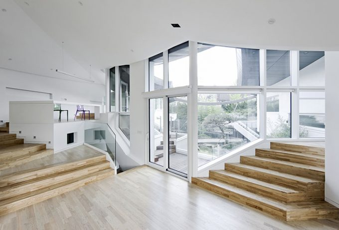Smart Central Point In The House With Open Interior Design Using Wide Glass Windows And Wood Palette Floor And Stairs