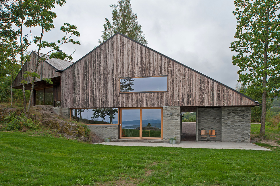 The Wooden House Blend With Green Turf