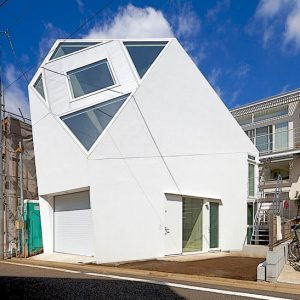 Unique House In Japan With Street Front Design Using White Concrete Wall And Glass