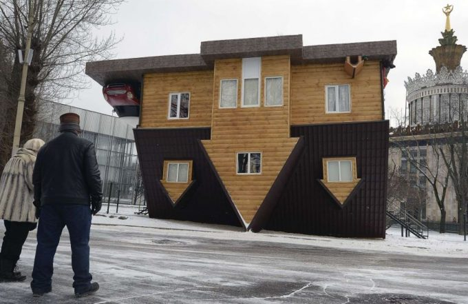 Upside Down House Facade With Wooden Wall And Brown Gable Roof