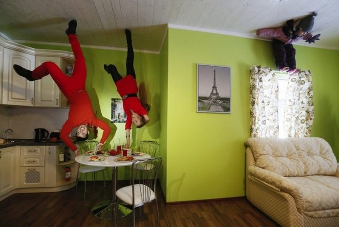 Weird Upside Down Family Room With Green Wall And Dark Wooden Floor Also White Ceiling