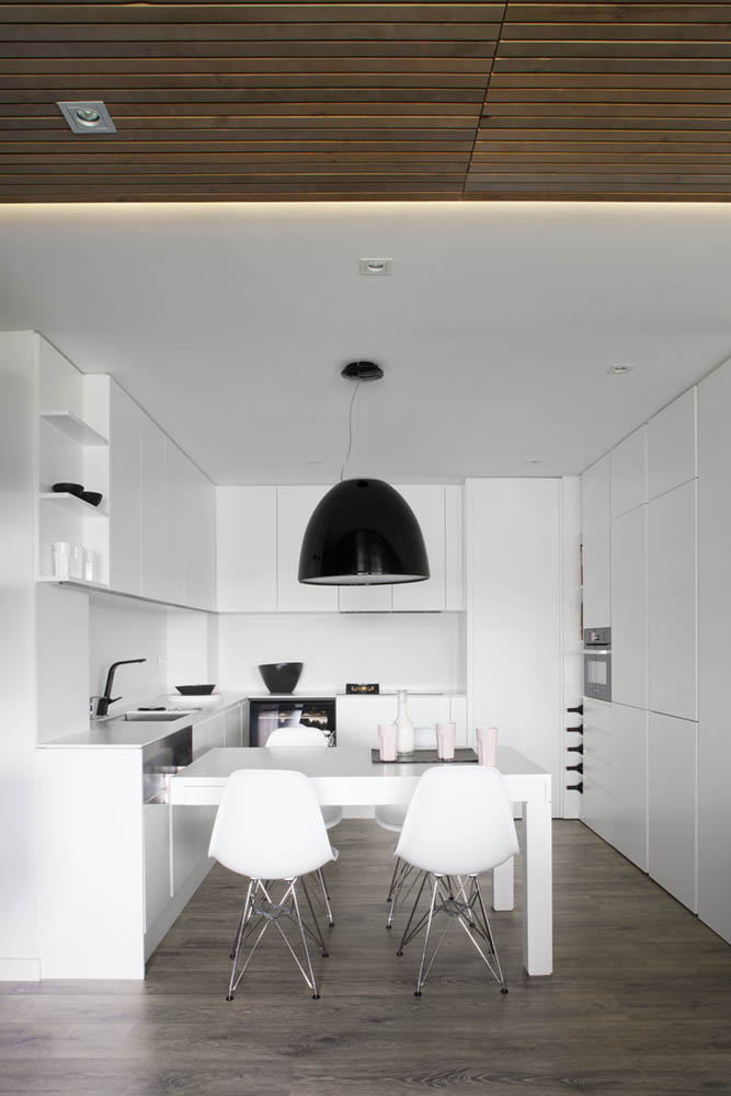 Amazing Minimalist White Kitchen Using White Kitchen Cabinets And White Eat In Kitchen Table