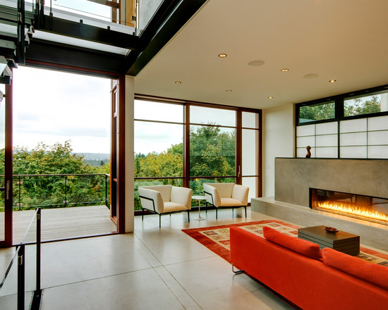 Amazing Modern Living Room With Red Sectional Sofa And Contemporary Ventless Gas Fireplace Also Glass Fences