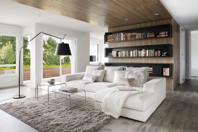 Apartment Contemporary Design With White Living Room With Wooden Plank Ceiling Decor And Wooden Bookcase Plus Modern White Sofa And Brown Furry Rugs