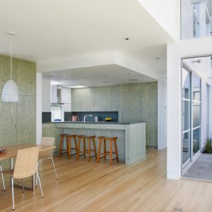 Awesome Contemporary Kitchenwith Light Green Kitchen Cabinets And Maple Wood Flooring