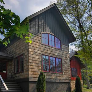 Awesome Vintage House Design With Board Batten Wood Siding And Green Landscape