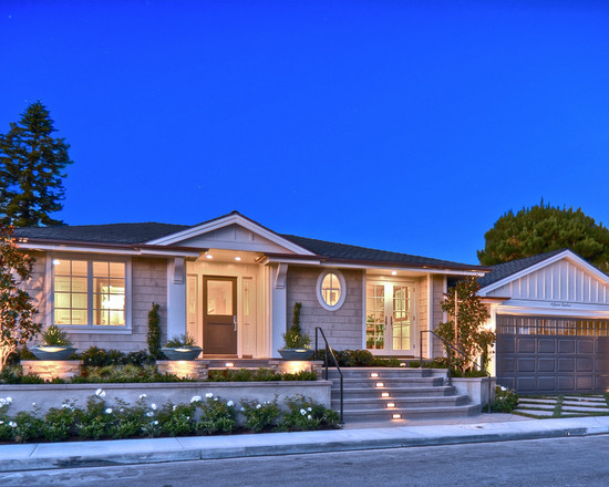 Beach Style Exterior With Ranch House Curb Appeal And Warm Lighting Plus Small Garden Decor