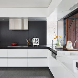 Beautiful Black And White Kitchen Design With Casement Window And White Cabinetry Plus Black Resin Countertop