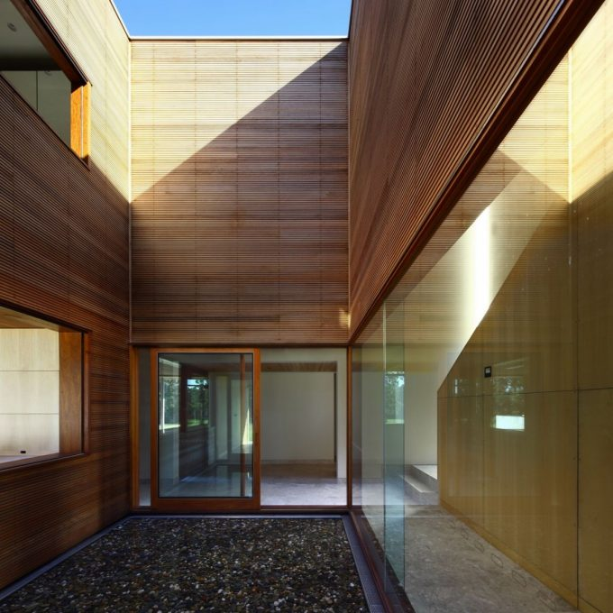 Beautiful Center Courtyard And Glass Walls And Wooden Shiding Exterior For Spacious Wooden Contemporary House Design