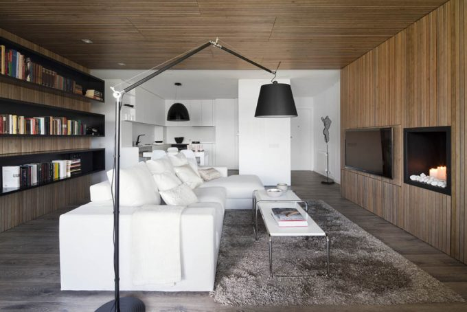 Beautiful Modern White Sofa And White Coffe Table Also Furry Rugs Area Plus Wall Mounted TV And Fake Fireplace Decor