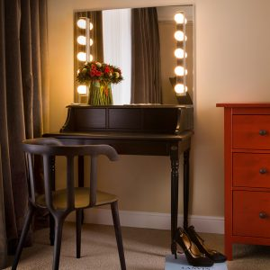 Classic Small Black Wooden Dressing Table And Brown Drapes In Master Bedroom Corner