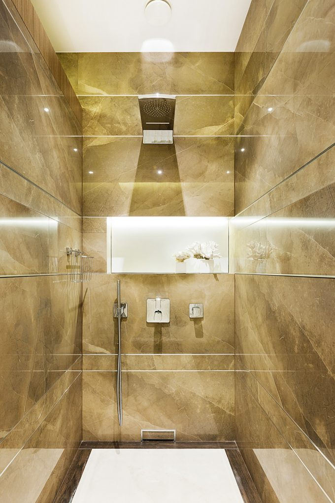 Clean Shower Space With Rain Drop Shower Head And Golden Marble Wall Aso White Floor And Ceiling Decor