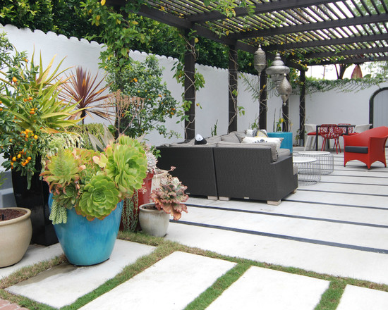 Contemporary Patio With Wood Pergola And Moroccan Lamps Decor Also Brown And Red Wicker Chairs Plus Concrete Flooring