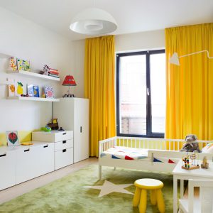 Cute Kids Bedroom With Green Rugs And White Shelves Also Yellow Drapes In White Interior Color