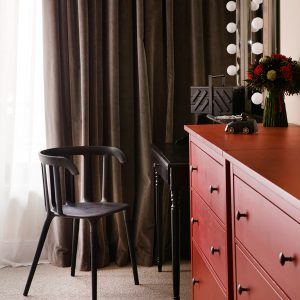 Dressing Table With Bulb Lamps And Red Cupboards Detail For Minimalist Apartment Decor