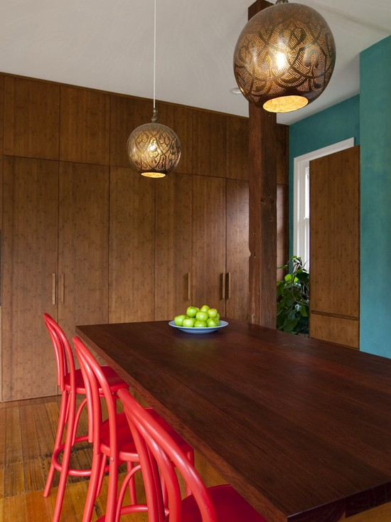 Eclectic Kitchen With Laminated Wood Table And Red Chairs Also Laminated Wood Cabinetry Plus Moroccan Lamps