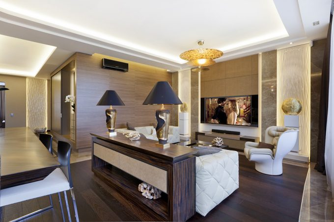 Exclusive Interior Design With Modern White Sofa And White Modern Lounge Chair Also Golden Pendant Lamps