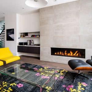Great Modern Living Room With Yellow Acrylic Chairs And Lounge Chaise Also Black Rugs With Floral Pattern Plus Contemporary Ventless Gas Fireplace