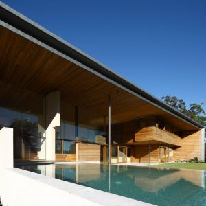 Infinity Swimming Pool With Awesome Terrace Of Wooden Interior House Decor With Spacy Landscape