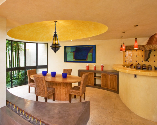 Mexican Dining Kitchen With Yellow Interior Decor And Oval Wood Dining Table Also Wicker Chairs