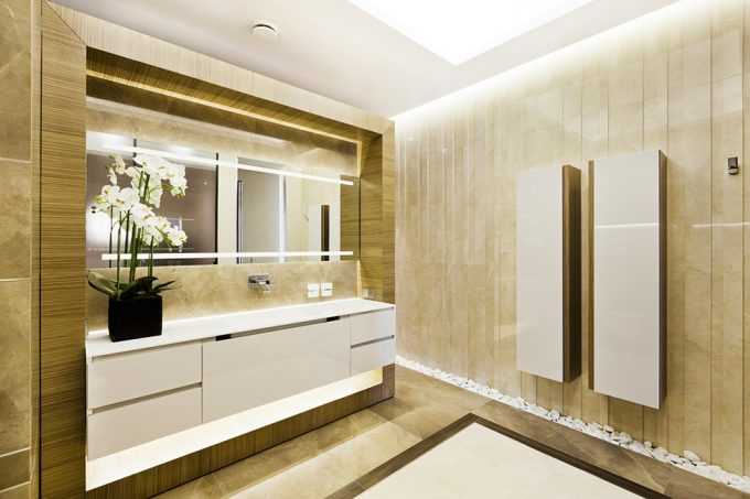 Modern Bathroom With Marble And Golden Wall Ornament Also Bright Ceiling Lighting Plus Golden Framed Mirror
