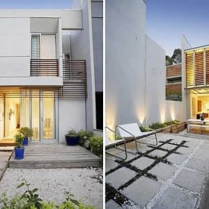 Modern Fizroy House Facade With Concrete Exterior And Glass Windows And Doors