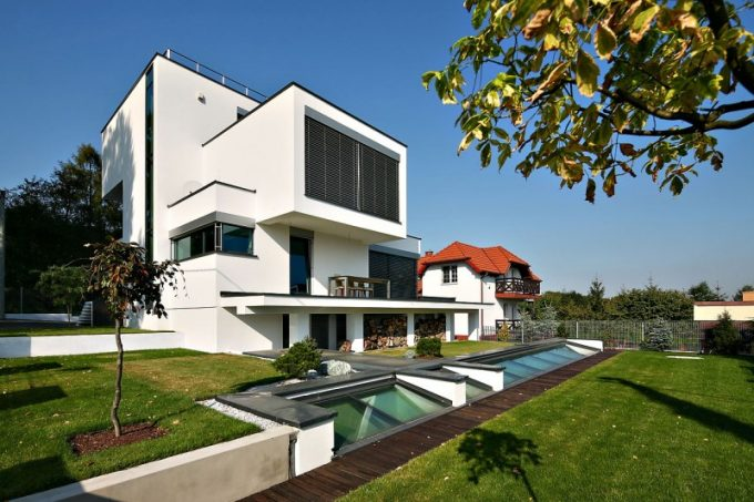 Modern House With Cube Shape And Modern Architecture And Small Landscape