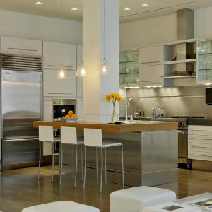 Modern Kithen With Glass Cabinetry And Silver Kitchen Vanity Also Glass Pendan Lamps