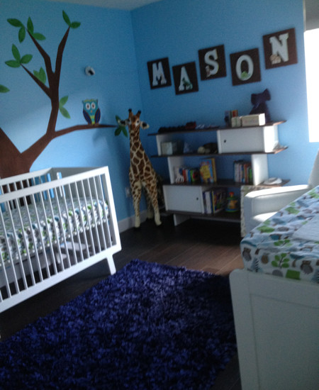 Modern Nursery Ideas For Boys With Blue Wall And Giraffe Decals Also White Crib Decor