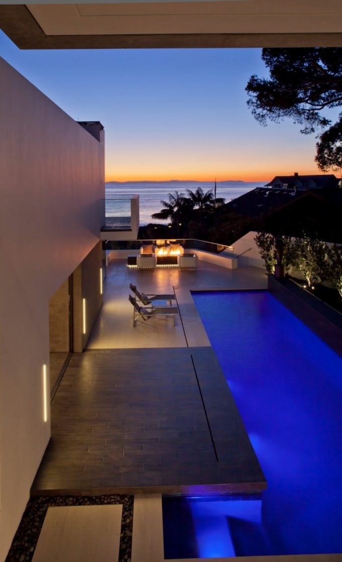 Night View Of The Infinity Pool And Cool Terrace With Warm Lighting Decor