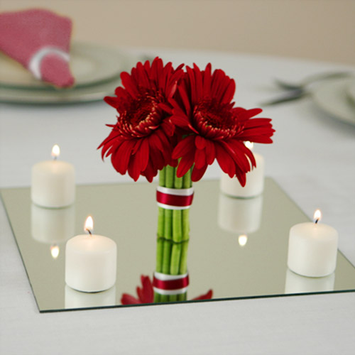 Red Flower And Canles With Mirror Center Pieces Over White Napkin For Romantic Dinner Settings
