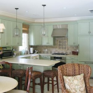 Rustic Kitchen With Light Green Kitchen Cabinets And Rustic Chairs