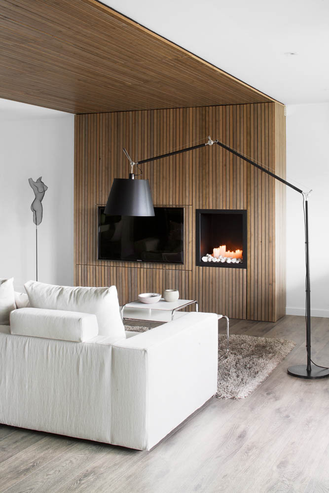 Simple Living Room Design With Minimalist Modern Sofa And Black Standing Floor Lamps