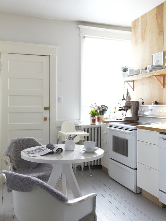 Small Kitchen With Round White Eat In Kitchen Tables And White Countertops For Small Apartment Design