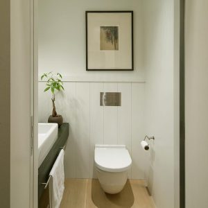 Small Powder Room With Wall Mounted Closet And Apron Sink Decor