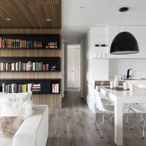 The Enterence With Wooden Flooring And White Interior Decorations