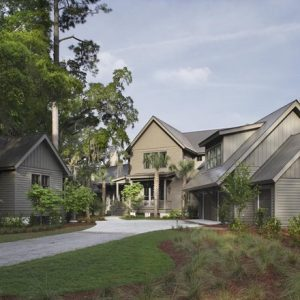 Traditional Exterior Using Painted Board And Batten Wood Siding Also Crushed Gravel Driveway