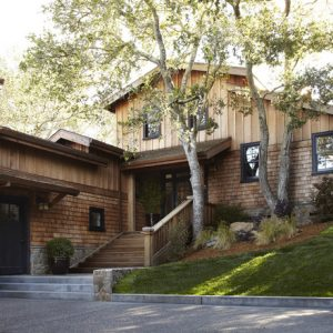 Traditional Exterior With Brick Wall And Board Batten Wood Siding Also Sand Stone Concrete Pavers