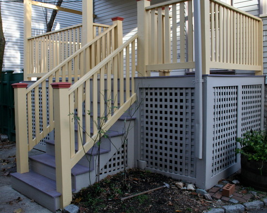 Traditional House With Decks With Grey Lattice And White Handrail
