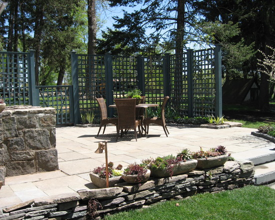 Transitional Patio With Natural Slate Stone Floor And Green Lattice Screen Designs And Stone Fireplace