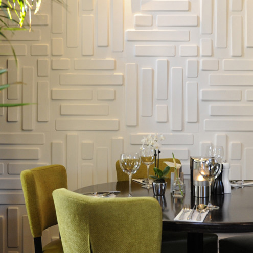 Calm Contemporary Family Room With Unusual Wallcoverings And Round Dining Table With Green Dining Chairs