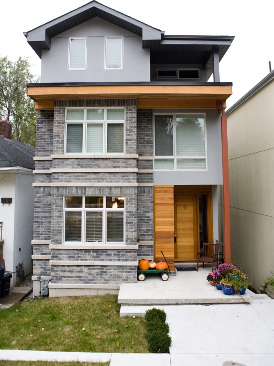 Contemporary House Exterior With Grey Bricks Colors And Concrete Floor Enterence Also Wooden Door Design