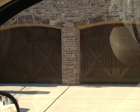 Traditional Garage Exterior With Stained Brick Color And Wood Garage Door Design