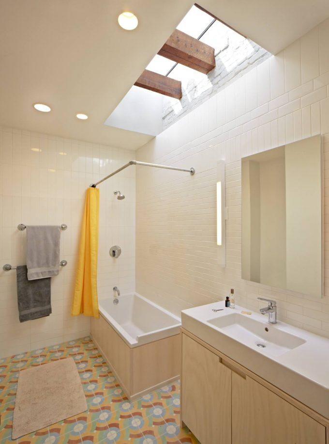 Appealing Bathroom Lighting With Skylights And Recessed Lighting Plus Towel Bar On White Subway Tile With Yellow Shower Curtain On Curtain Rod Also Walk In Shower Ideas