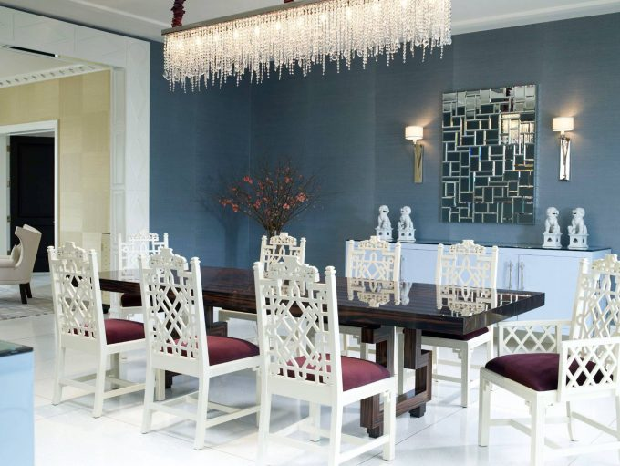 Appealing Ebony Dining Table Plus White Dining Chairs In Contemporary Dining Room With Contemporary Chandeliers And Wall Sconce Also Wall Mirror On Gray Wall